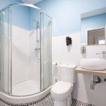 Modern bathroom with show and basin.